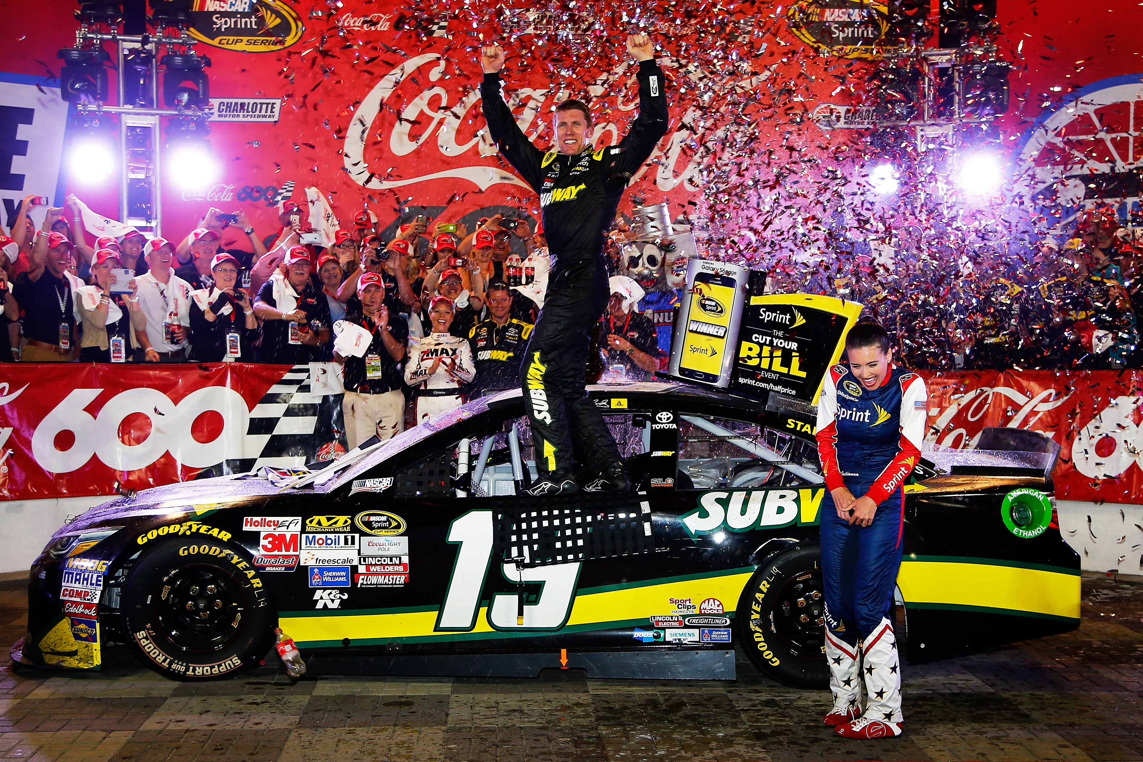 Carl edwards flips again after winning the 56th annual for Charlotte motor speedway drag racing