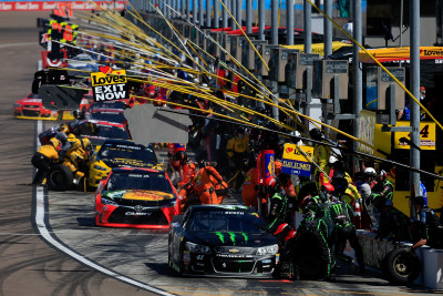 AVONDALE, AZ - MARCH 13: Cars pit during the NASCAR Sprint Cup Series Good Sam 500 at Phoenix International Raceway on March 13, 2016 in Avondale, Arizona. (Photo by Chris Trotman/Getty Images)