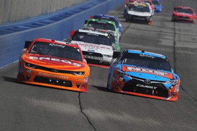 FONTANA, CA - MARCH 19: Kyle Larson, driver of the #42 ENEOS Chevrolet, and Kyle Busch, driver of the #18 NOS Energy Drink Toyota, lead a pack of cars during the NASCAR Xfinity Series TreatMyClot.com 300 at Auto Club Speedway on March 19, 2016 in Fontana, California. (Photo by Jonathan Moore/Getty Images)