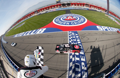FONTANA, CA - MARCH 19: Austin Dillon, driver of the #2 Rheem Chevrolet, takes the checkered flag to win the NASCAR Xfinity Series TreatMyClot.com 300 at Auto Club Speedway on March 19, 2016 in Fontana, California. (Photo by Brian Lawdermilk/NASCAR via Getty Images)
