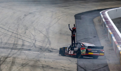 DOVER, DE - MAY 14: Erik Jones, driver of the #20 Reser's Fine Foods Toyota, celebrates after winning the NASCAR XFINITY Series Ollie's Bargain Outlet 200 at Dover International Speedway on May 14, 2016 in Dover, Delaware. (Photo by Jonathan Ferrey/Getty Images)