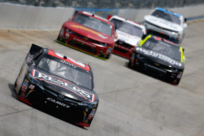 DOVER, DE - MAY 14: Erik Jones, driver of the #20 Reser's Fine Foods Toyota, leads a pack of cars during the NASCAR XFINITY Series Ollie's Bargain Outlet 200 Heat #1 at Dover International Speedway on May 14, 2016 in Dover, Delaware. (Photo by Jonathan Ferrey/Getty Images)