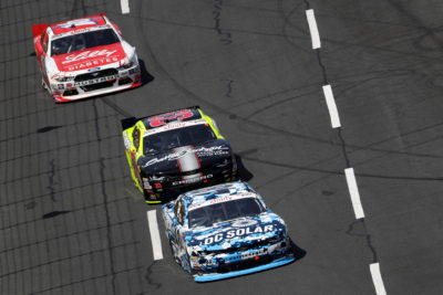 CHARLOTTE, NC - MAY 28: Brennan Poole, driver of the #48 DC Solar Chevrolet, leads a pack of cars during the NASCAR XFINITY Series Hisense 300 at Charlotte Motor Speedway on May 28, 2016 in Charlotte, North Carolina. (Photo by Streeter Lecka/Getty Images)