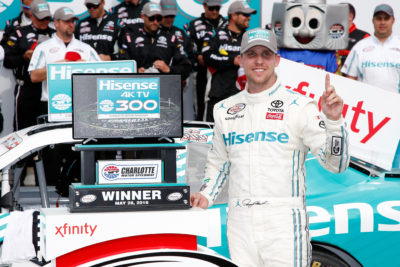 CHARLOTTE, NC - MAY 28: Denny Hamlin, driver of the #18 Hisense USA Toyota, celebrates in Victory Lane after winning the NASCAR XFINITY Series Hisense 300 at Charlotte Motor Speedway on May 28, 2016 in Charlotte, North Carolina. (Photo by Todd Warshaw/NASCAR via Getty Images)