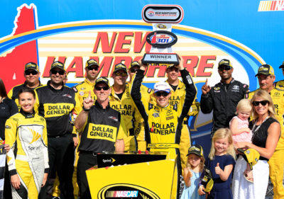 LOUDON, NH - JULY 17: Matt Kenseth, driver of the #20 Dollar General Toyota, celebrates in Victory Lane after winning the NASCAR Sprint Cup Series New Hampshire 301 at New Hampshire Motor Speedway on July 17, 2016 in Loudon, New Hampshire. (Photo by Chris Trotman/Getty Images)