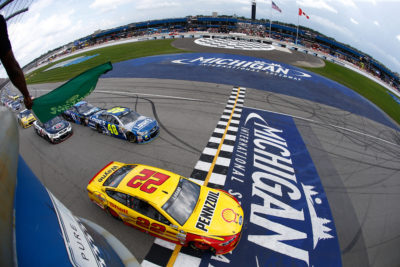 BROOKLYN, MI - AUGUST 28: Joey Logano, driver of the #22 Shell Pennzoil Ford, and Jimmie Johnson, driver of the #48 Lowe's Chevrolet, lead the field to the green flag during the NASCAR Sprint Cup Series Pure Michigan 400 at Michigan International Speedway on August 28, 2016 in Brooklyn, Michigan. (Photo by Jeff Zelevansky/NASCAR via Getty Images)