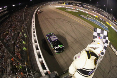 RICHMOND, VA - SEPTEMBER 10: Denny Hamlin, driver of the #11 FedEx Ground Toyota, takes the checkered flag to win the NASCAR Sprint Cup Series Federated Auto Parts 400 at Richmond International Raceway on September 10, 2016 in Richmond, Virginia. (Photo by Chris Graythen/NASCAR via Getty Images) *** Local Caption *** Denny Hamlin