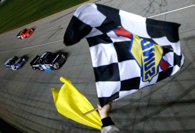 JOLIET, IL - SEPTEMBER 16: Kyle Busch, driver of the #18 SiriusXM Toyota, takes the checkered flag to win the NASCAR Camping World Truck Series American Ethanol E15 225 at Chicagoland Speedway on September 16, 2016 in Joliet, Illinois. (Photo by Brian Lawdermilk/NASCAR via Getty Images)