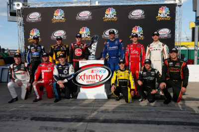 JOLIET, IL - SEPTEMBER 17: (Back Row L-R)Darrell Wallace Jr, driver of the #6 TMNT Shredder Ford, Brendan Gaughan, driver of the #62 American Ethanol/Thorntons Chevrolet, Ty Dillon, driver of the #3 Rheem Chevrolet, Elliott Sadler, driver of the #1 OneMain Chevrolet, Ryan Reed, driver of the #16 Lilly Diabetes/American Diabetes Association Ford, Daniel Suarez, driver of the #19 ARRIS/TMNT Michelangelo Toyota, (Front Row L-R)Erik Jones, driver of the #20 Hisense Toyota, Justin Allgaier, driver of the #7 LetsTalkFood.com Chevrolet, Brennan Poole, driver of the #48 DC Solar Chevrolet, Brandon Jones, driver of the #33 Tide/Menards Chevrolet, Blake Koch, driver of the #11 LeafFilter Gutter Protection Chevrolet, and Ryan Sieg, driver of the #39 RSS Racing Chevrolet, pose with the NASCAR XFINITY Series trophy after the NASCAR XFINITY Series Drive for Safety 300 at Chicagoland Speedway on September 17, 2016 in Joliet, Illinois. (Photo by Brian Lawdermilk/NASCAR via Getty Images)
