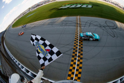 JOLIET, IL - SEPTEMBER 17: Erik Jones, driver of the #20 Hisense Toyota, crosses the finish line to win the NASCAR XFINITY Series Drive for Safety 300 at Chicagoland Speedway on September 17, 2016 in Joliet, Illinois. (Photo by Brian Lawdermilk/NASCAR via Getty Images)