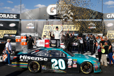 JOLIET, IL - SEPTEMBER 17: Erik Jones, driver of the #20 Hisense Toyota, celebrates in Victory Lane after winning the NASCAR XFINITY Series Drive for Safety 300 at Chicagoland Speedway on September 17, 2016 in Joliet, Illinois. (Photo by Jeff Zelevansky/NASCAR via Getty Images)