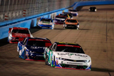 AVONDALE, AZ - NOVEMBER 12: Blake Koch, driver of the #11 LeafFilter Gutter Protection Chevrolet, leads a pack of cars during the NASCAR XFINITY Series Ticket Galaxy 200 at Phoenix International Raceway on November 12, 2016 in Avondale, Arizona. (Photo by Chris Trotman/NASCAR via Getty Images)
