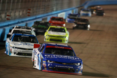 AVONDALE, AZ - NOVEMBER 12: Elliott Sadler, driver of the #1 OneMain Chevrolet, leads a pack of cars during the NASCAR XFINITY Series Ticket Galaxy 200 at Phoenix International Raceway on November 12, 2016 in Avondale, Arizona. (Photo by Sarah Crabill/Getty Images)
