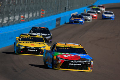 AVONDALE, AZ - NOVEMBER 13: Kyle Busch, driver of the #18 M&M's Toyota, leads a pack of cars during the NASCAR Sprint Cup Series Can-Am 500 at Phoenix International Raceway on November 13, 2016 in Avondale, Arizona. (Photo by Chris Trotman/NASCAR via Getty Images)