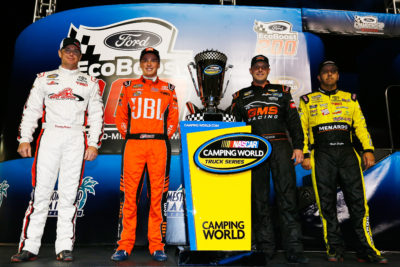 HOMESTEAD, FL - NOVEMBER 18: (L-R) Timothy Peters, driver of the #17 Red Horse Racing Toyota, Christopher Bell, driver of the #4 JBL Toyota, Johnny Sauter, driver of the #21 Allegiant Travel Chevrolet, and Matt Crafton, driver of the #88 Black Label Bacon/Menards Toyota, pose with the Camping World Truck Series trophy prior to the NASCAR Camping World Truck Series Ford EcoBoost 200 at Homestead-Miami Speedway on November 18, 2016 in Homestead, Florida. (Photo by Jonathan Ferrey/NASCAR via Getty Images)