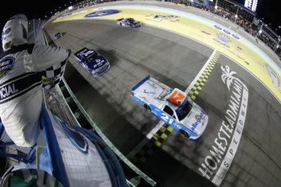 HOMESTEAD, FL - NOVEMBER 18: Johnny Sauter, driver of the #21 Allegiant Travel Chevrolet, crosses the finish line to win the NASCAR Camping World Truck Series Championship at Homestead-Miami Speedway on November 18, 2016 in Homestead, Florida. (Photo by Sean Gardner/NASCAR via Getty Images)