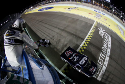 HOMESTEAD, FL - NOVEMBER 18: William Byron, driver of the #9 Liberty University Toyota, takes the checkered flag to win the NASCAR Camping World Truck Series Ford EcoBoost 200 at Homestead-Miami Speedway on November 18, 2016 in Homestead, Florida. (Photo by Sean Gardner/NASCAR via Getty Images)