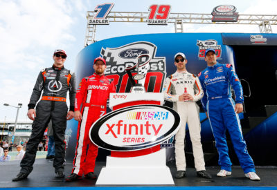 HOMESTEAD, FL - NOVEMBER 19: Erik Jones, driver of the #20 GameStop/PowerA Toyota, Justin Allgaier, driver of the #7 BRANDT Chevrolet, Daniel Suarez, driver of the #19 ARRIS Toyota, and Elliott Sadler, driver of the #1 OneMain Chevrolet, pose with the Championship Trophy during pre-race ceremonies for the NASCAR XFINITY Series Ford EcoBoost 300 at Homestead-Miami Speedway on November 19, 2016 in Homestead, Florida. (Photo by Jonathan Ferrey/NASCAR via Getty Images)