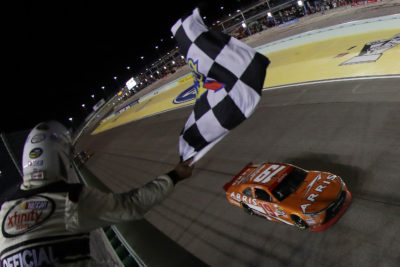 HOMESTEAD, FL - NOVEMBER 19: Daniel Suarez, driver of the #19 ARRIS Toyota, takes the checkered flag to win the NASCAR XFINITY Series Ford EcoBoost 300 and the NASCAR XFINITY Series Championship at Homestead-Miami Speedway on November 19, 2016 in Homestead, Florida. (Photo by Sean Gardner/NASCAR via Getty Images)