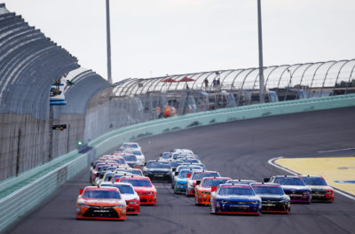 HOMESTEAD, FL - NOVEMBER 19: Daniel Suarez, driver of the #19 ARRIS Toyota, leads the field past the green flag to start the NASCAR XFINITY Series Ford EcoBoost 300 at Homestead-Miami Speedway on November 19, 2016 in Homestead, Florida. (Photo by Chris Trotman/Getty Images)