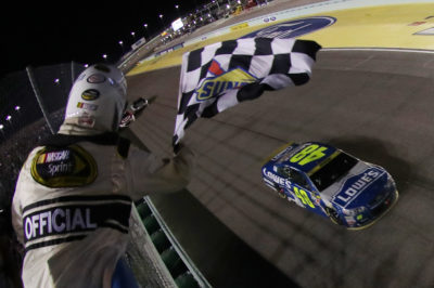 HOMESTEAD, FL - NOVEMBER 20: Jimmie Johnson, driver of the #48 Lowe's Chevrolet, takes the checkered flag to win the NASCAR Sprint Cup Series Ford EcoBoost 400 and the 2016 NASCAR Sprint Cup Series Championship at Homestead-Miami Speedway on November 20, 2016 in Homestead, Florida. (Photo by Sean Gardner/NASCAR via Getty Images)
