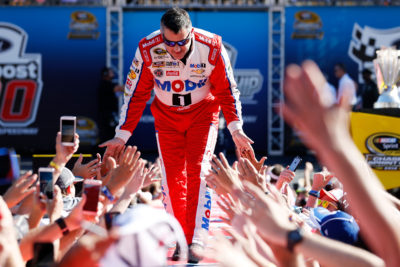 HOMESTEAD, FL - NOVEMBER 20: Tony Stewart, driver of the #14 Always a Racer/Mobil 1 Chevrolet, greets fans as he is introduced prior to the NASCAR Sprint Cup Series Ford EcoBoost 400 at Homestead-Miami Speedway on November 20, 2016 in Homestead, Florida. (Photo by Chris Trotman/Getty Images)