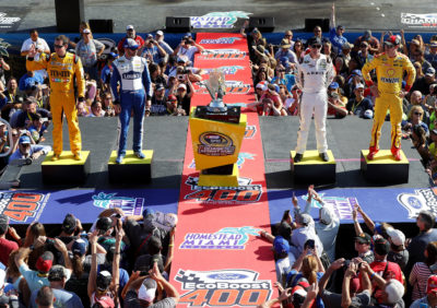 HOMESTEAD, FL - NOVEMBER 20: (L-R) NASCAR Sprint Cup Series Chase drivers Kyle Busch, driver of the #18 M&M's Toyota, Jimmie Johnson, driver of the #48 Lowe's Chevrolet, Carl Edwards, driver of the #19 ARRIS Toyota, and Joey Logano, driver of the #22 Shell Pennzoil Ford, pose with the NASCAR Sprint Cup Series Championship trophy prior to the NASCAR Sprint Cup Series Ford EcoBoost 400 at Homestead-Miami Speedway on November 20, 2016 in Homestead, Florida. (Photo by Sean Gardner/NASCAR via Getty Images)