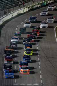 FORT WORTH, TX - NOVEMBER 04: Spencer Gallagher, driver of the #23 Allegiant Travel Chevrolet, leads the field to the green flag to start the NASCAR Camping World Truck Series Striping Technology 350 at Texas Motor Speedway on November 4, 2016 in Fort Worth, Texas. (Photo by Brian Lawdermilk/Getty Images)