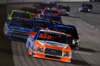 FORT WORTH, TX - NOVEMBER 04: Daniel Hemric, driver of the #19 Blue Gate Bank Ford, leads a pack of trucks during the NASCAR Camping World Truck Series Striping Technology 350 at Texas Motor Speedway on November 4, 2016 in Fort Worth, Texas. (Photo by Jared C. Tilton/Getty Images)