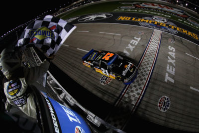 FORT WORTH, TX - NOVEMBER 04: Johnny Sauter, driver of the #21 Allegiant Travel Chevrolet, takes the checkered flag to win the NASCAR Camping World Truck Series Striping Technology 350 at Texas Motor Speedway on November 4, 2016 in Fort Worth, Texas. (Photo by Sean Gardner/NASCAR via Getty Images)