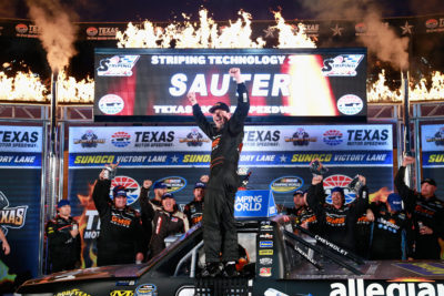FORT WORTH, TX - NOVEMBER 04: Johnny Sauter, driver of the #21 Allegiant Travel Chevrolet, celebrates in Victory Lane after winning the NASCAR Camping World Truck Series Striping Technology 350 at Texas Motor Speedway on November 4, 2016 in Fort Worth, Texas. (Photo by Matt Sullivan/NASCAR via Getty Images)
