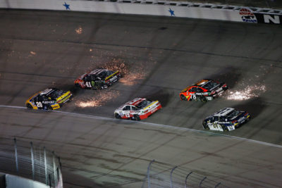 FORT WORTH, TX - NOVEMBER 06: Sparks are seen as Matt Kenseth, driver of the #20 DEWALT FLEXVOLT Toyota, leads a pack of cars during the NASCAR Sprint Cup Series AAA Texas 500 at Texas Motor Speedway on November 6, 2016 in Fort Worth, Texas. (Photo by Brian Lawdermilk/Getty Images)