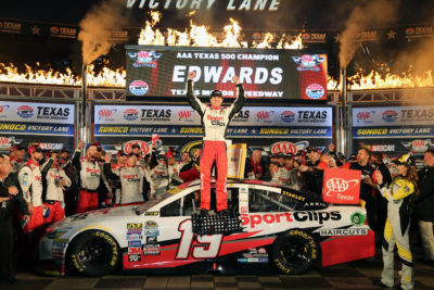 FORT WORTH, TX - NOVEMBER 06: Carl Edwards, driver of the #19 Sport Clips Toyota, celebrates in Victory Lane after winning the rain-shortened NASCAR Sprint Cup Series AAA Texas 500 at Texas Motor Speedway on November 6, 2016 in Fort Worth, Texas. (Photo by Jerry Markland/Getty Images)