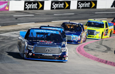 MARTINSVILLE, VA - OCTOBER 29: William Byron, driver of the #9 Liberty University Toyota, leads a pack of trucks during the NASCAR Camping World Truck Series Texas Roadhouse 200 presented by Alpha Energy Solutions at Martinsville Speedway on October 29, 2016 in Martinsville, Virginia. (Photo by Matt Sullivan/NASCAR via Getty Images)