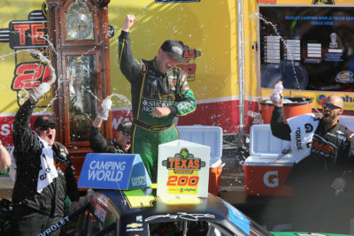 MARTINSVILLE, VA - OCTOBER 29: Johnny Sauter, driver of the #21 Smokey Mountain Herbal Snuff Chevrolet, celebrates in Victory Lane after winning the NASCAR Camping World Truck Series Texas Roadhouse 200 presented by Alpha Energy Solutions at Martinsville Speedway on October 29, 2016 in Martinsville, Virginia. (Photo by Jerry Markland/Getty Images)